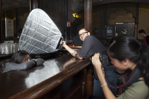 Assisting a young photographer at a high school photo workshop